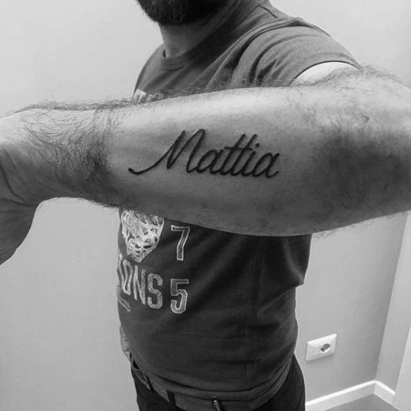 Mattia Outer Forearm Cursive Guys Name Tattoos