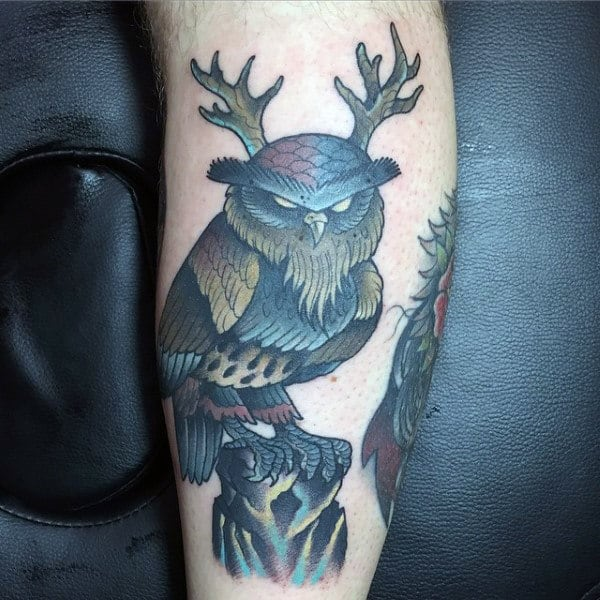Mean Looking Owl With Antlers Mens Arm Tattoo Design Ideas