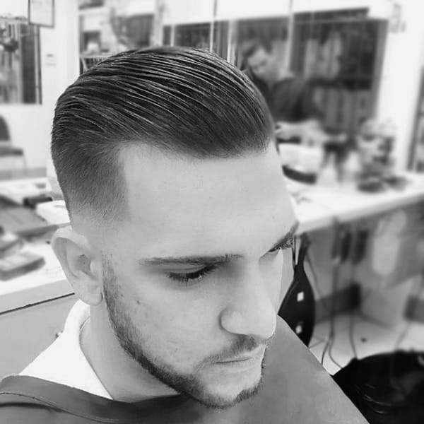 Medium Lenth Slicked Classy Guys Haircuts Comb Over