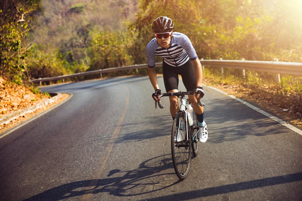 men cycling road bike during morning time