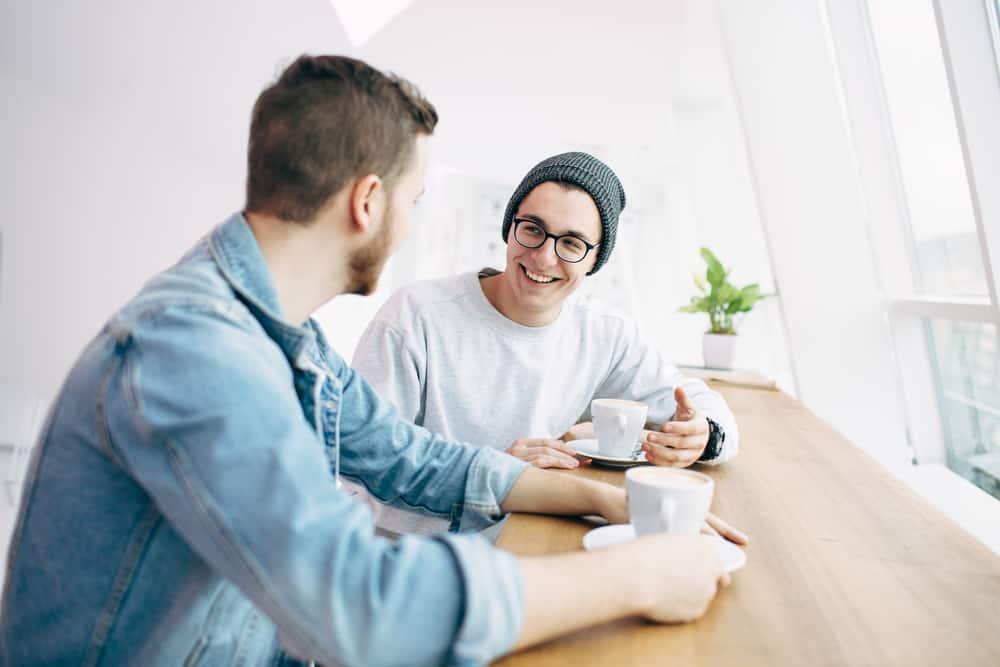 men sitting near window funny talking