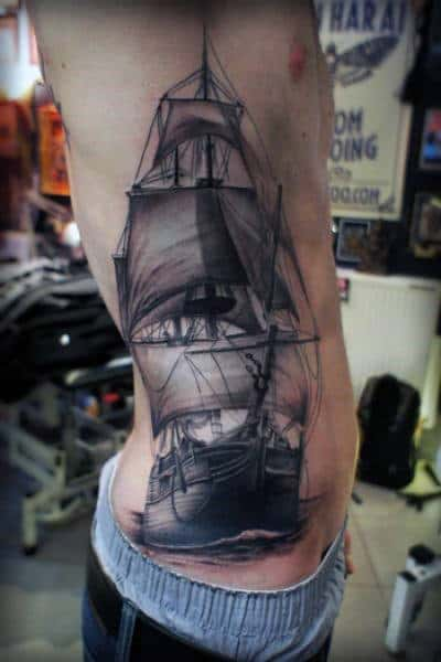 Men Torso Black And Grey Ship Tattoo