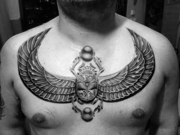 mens 3d scarab bettle upper chest tattoo