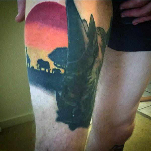 Mens African Sunset With Animals Tattoo On Thigh