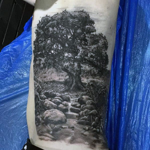 Mens Amazing Pencil Art Oak Tree And Stream Tattoo On Side Ribs
