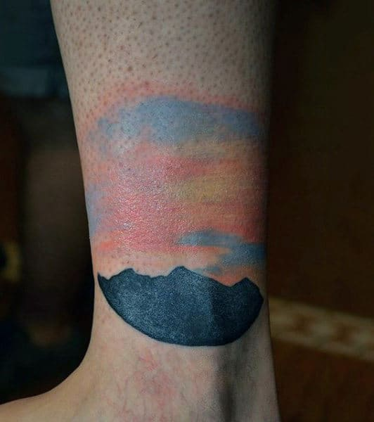 Mens Ankle Tattoo Of Mountain Silhouette At Sunset