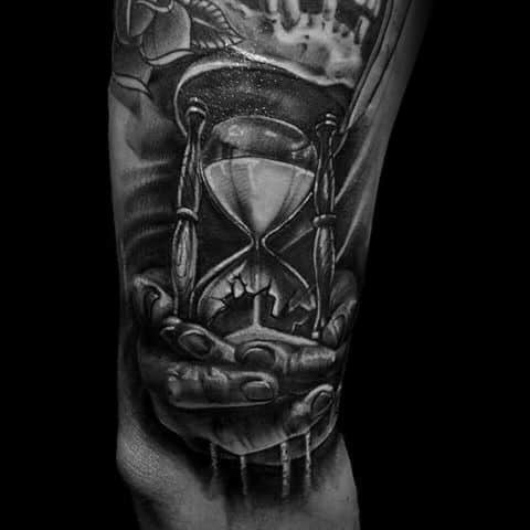 Mens Arm Broken Hourglass With Hands Holding Falling Sand Tattoo