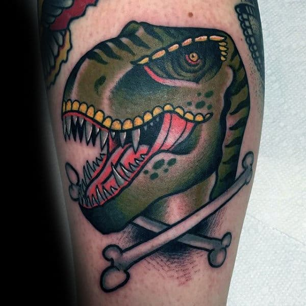 Mens Arms Green Dinosaur With Crossed Bones Tattoo