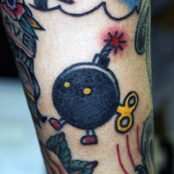Mens Arms Walking Bobm With Key Tattoo Ideas