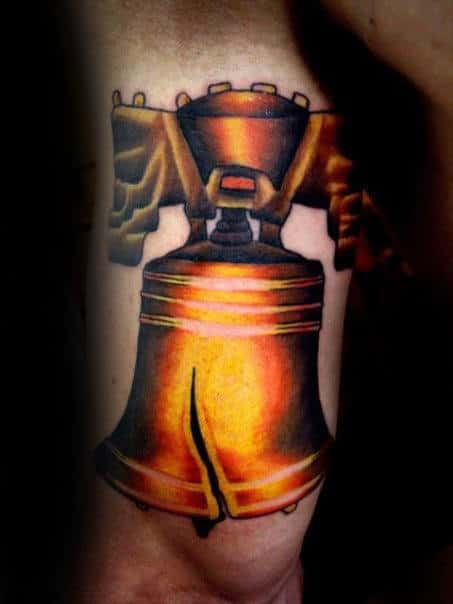 Mens Back Of Arm Gold Liberty Bell Tattoo Inspiration