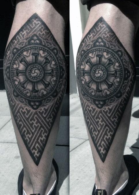 Mens Back Of Leg Pattern Geometrical Wheel Or Dharma Tattoos