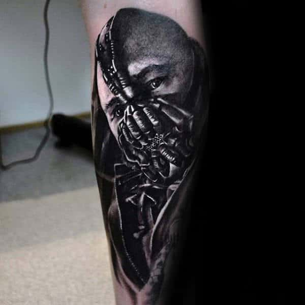 Mens Bane Themed Forearm Tattoo With Dark Shaded Ink Design