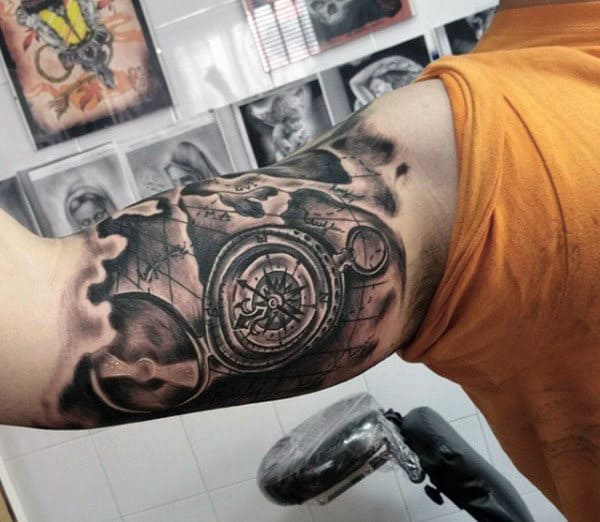 50 world map tattoo designs for men adventure the globe mens bicep map tattoo in black ink gumiabroncs Gallery