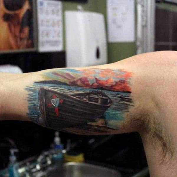 Mens Bicep Piece Tattoo Of Boat On A Lake At Sunset