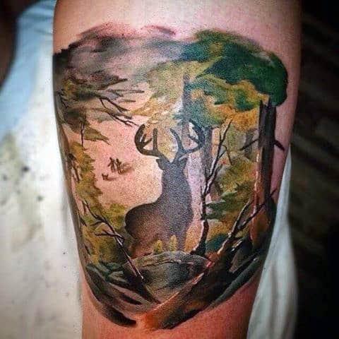 Mens Bicep Tattoo Of Deering Roaming Through The Woods