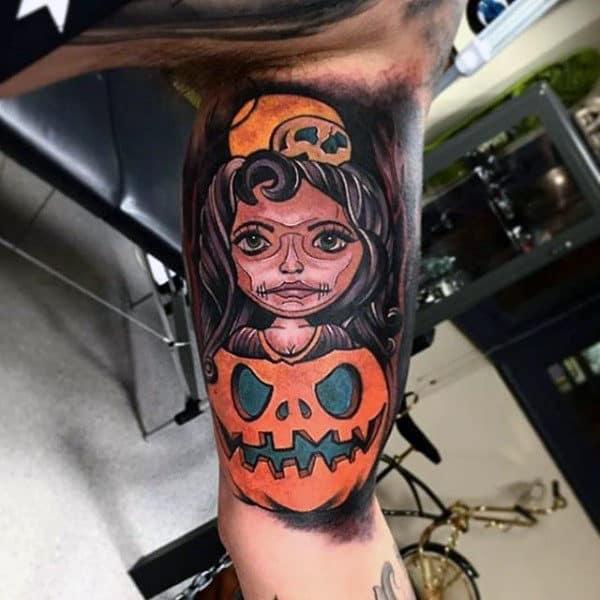 Mens Bicep Tattoo Of Female Inside Pumpkin