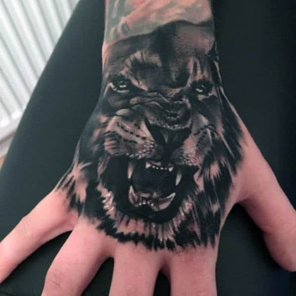 Mens Black And Grey Creative Lion Hand Tattoo