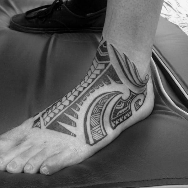 Mens Black Ink Foot Hawaiian Tattoo With Tribal Design