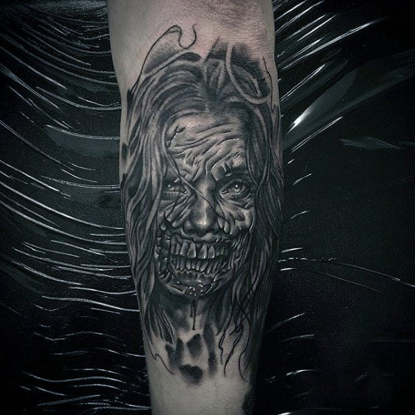 Mens Black Ink Shaded Female Zombie Tattoo On Outer Forearm