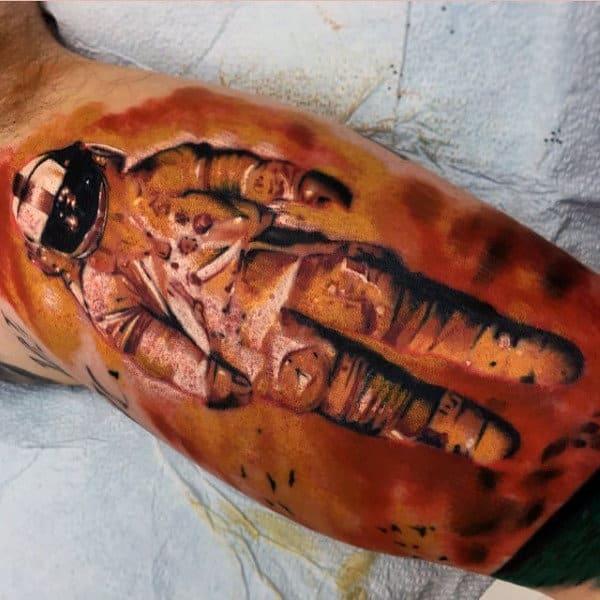 Mens Calves Bronze Colored Astronaut Tattoo