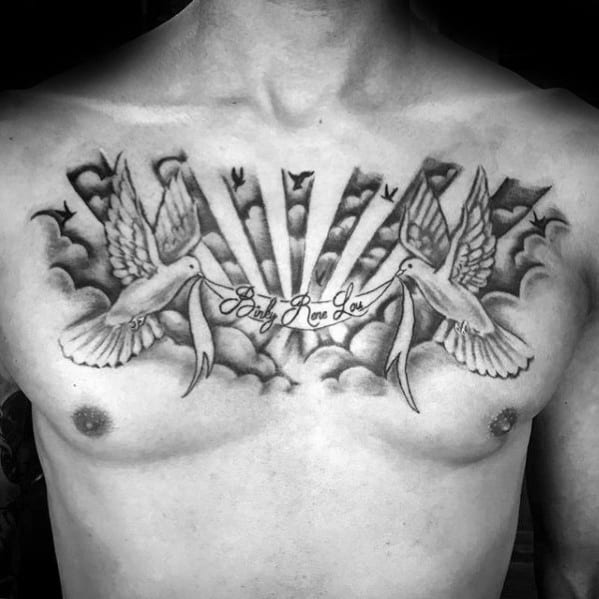 Mens Chest Tattoo Of Doves Holding Banner In Clouds