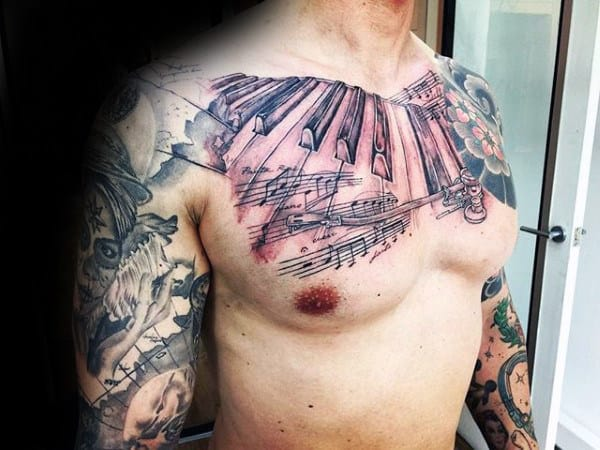 Mens Chest Tattoo Of Piano Keys With Musical Notes