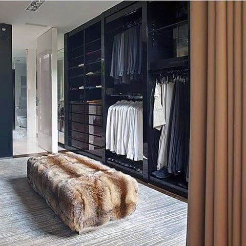 Mens Closet With Black Cabinets On Wall