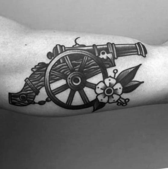 Mens Cool Iner Arm Bicep Traditional Flower With Cannon Tattoo Ideas