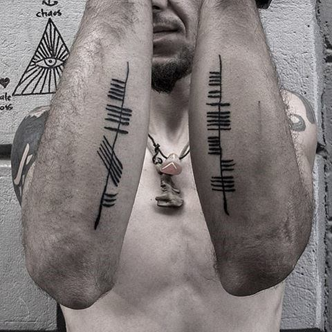 Mens Cool Ogham Tattoo Ideas On Outer Forearms
