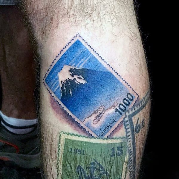 Mens Cool Postage Stamp Tattoo Ideas On Leg