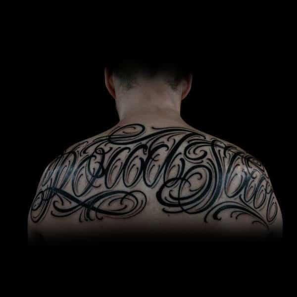 Mens Decorative Script Upper Back Black Ink Tattoo Design Inspiration