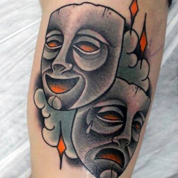 Mens Drama Mask Tattoo With Old School Traditional Design On Inner Arm Bicep
