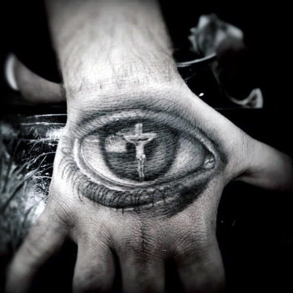 Mens Eye With Jesus On The Cross Hand Tattoo Design