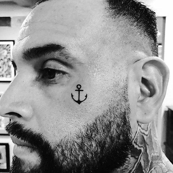 mens face black ink small anchor tattoo