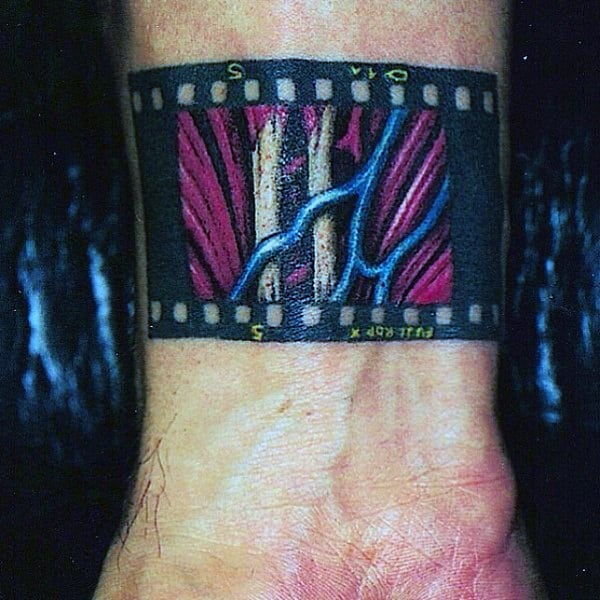 Mens Film Strip With Muscle On Wrist