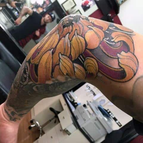 Mens Flower Petal Elbow Tattoo In Yellow Ink