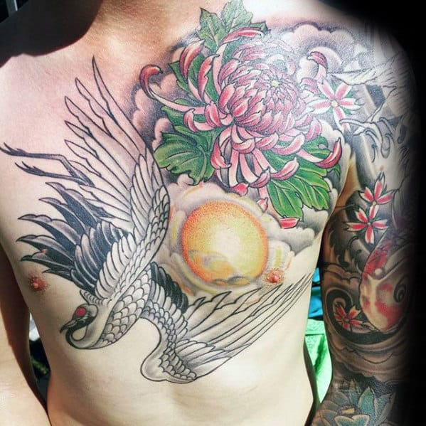 Mens Flower With Crane And Sun Chest Tattoos