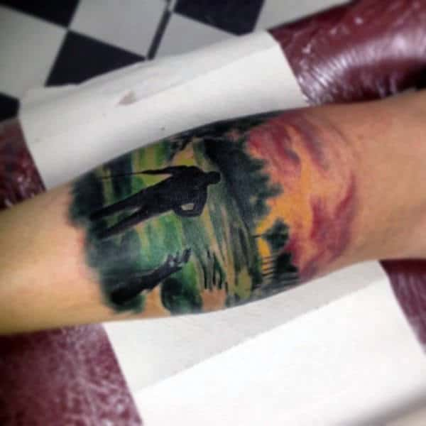 Mens Forearms Amazing Painitng Of Golfer Tattoos