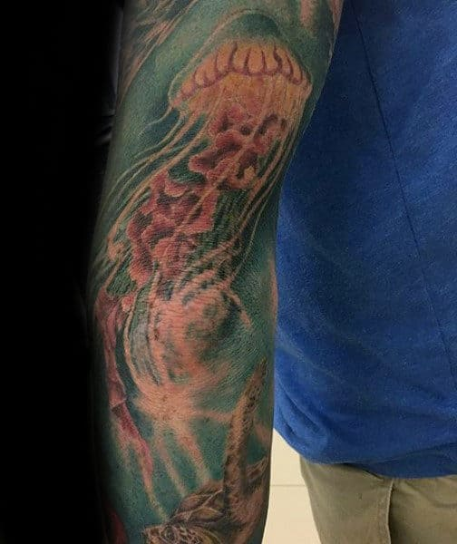 Mens Forearms Blue Sea And Jellyfish Tattoo