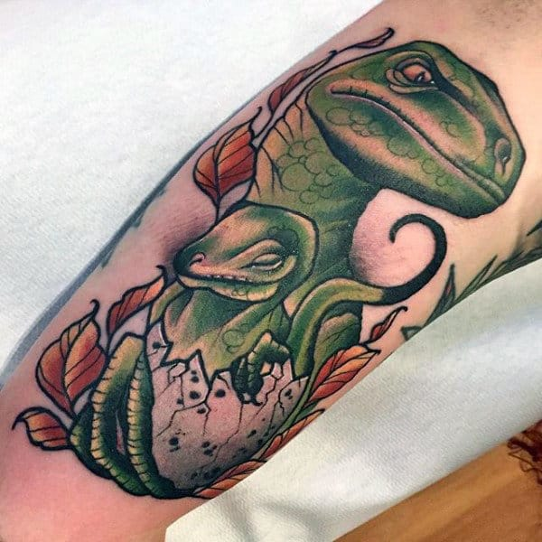 Mens Forearms Green Dinosaur And Baby Tattoo
