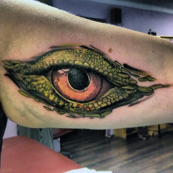 Mens Forearms Honey Colored Lizard Eye Tattoo