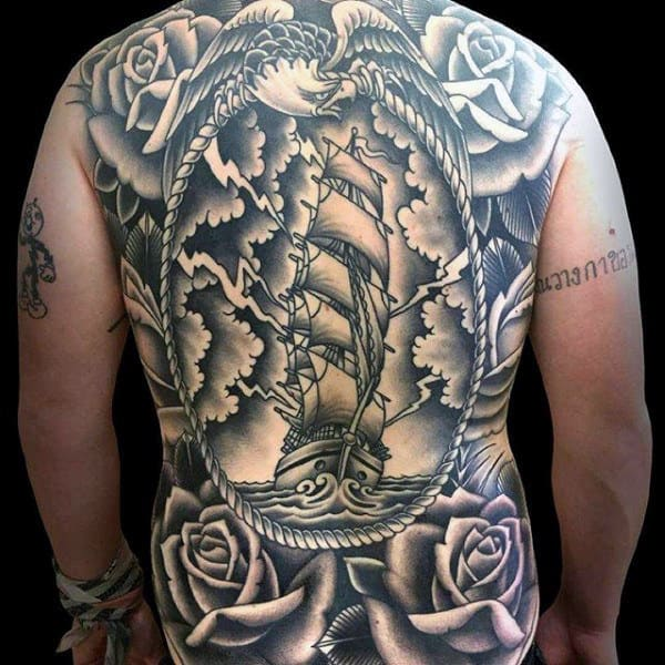 eb9ec85e98b3e Mens Full Back Fabulous Large Sailed Ship On Stormy Night And Rose Tattoo. Mens  Full Back Face Tattoo With Gigantic Eye And Lightening Effects