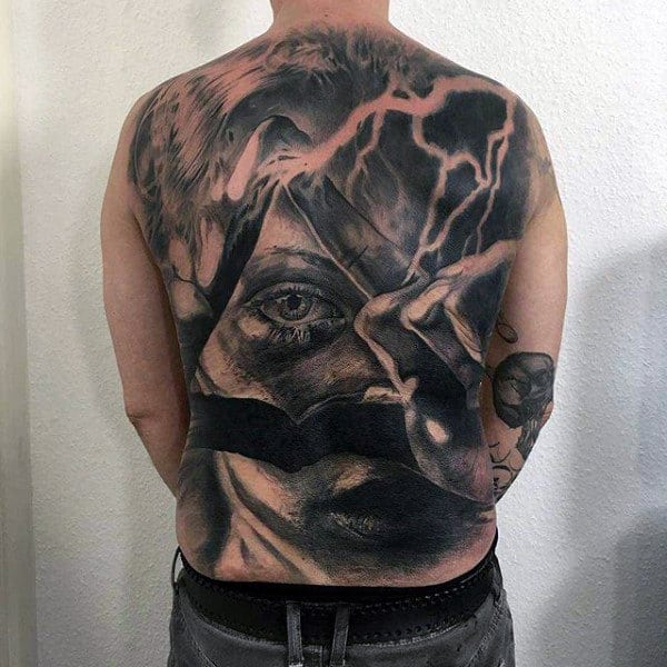 Mens Full Back Face Tattoo With Gigantic Eye And Lightening Effects