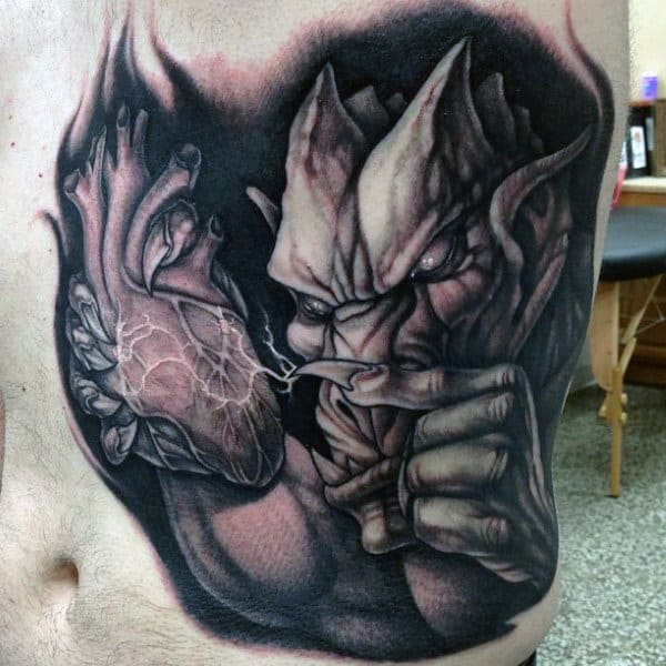 Mens Gargoyle With Heart Rib Cage Side Of Body Tattoo Ideas