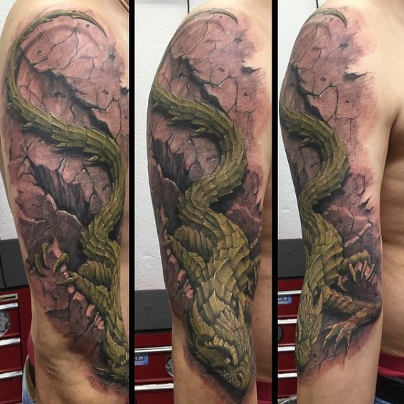 Mens Green Lizard Crawling Over Stone Half Sleeve Tattoo