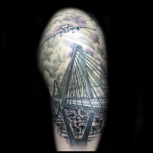 Mens Half Sleeve Airplane Flying Over Bridge Tattoo
