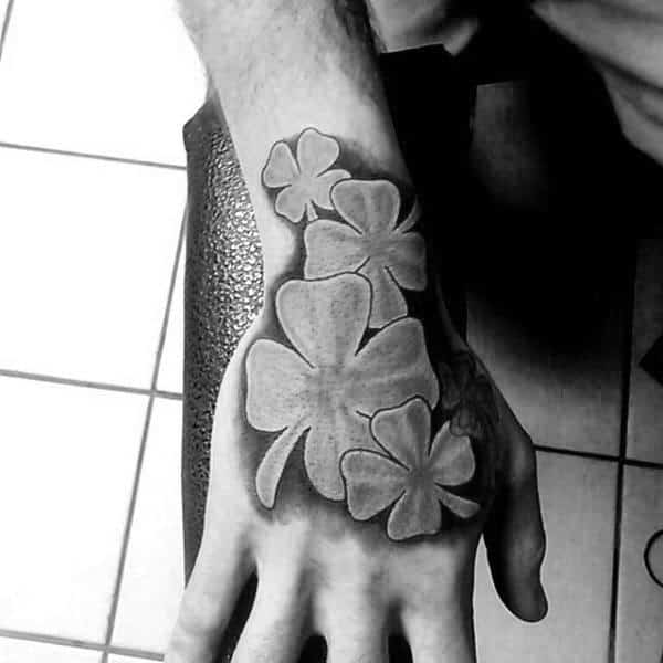 Mens Hand And Wrist Four Leaf Clovers Tattoos
