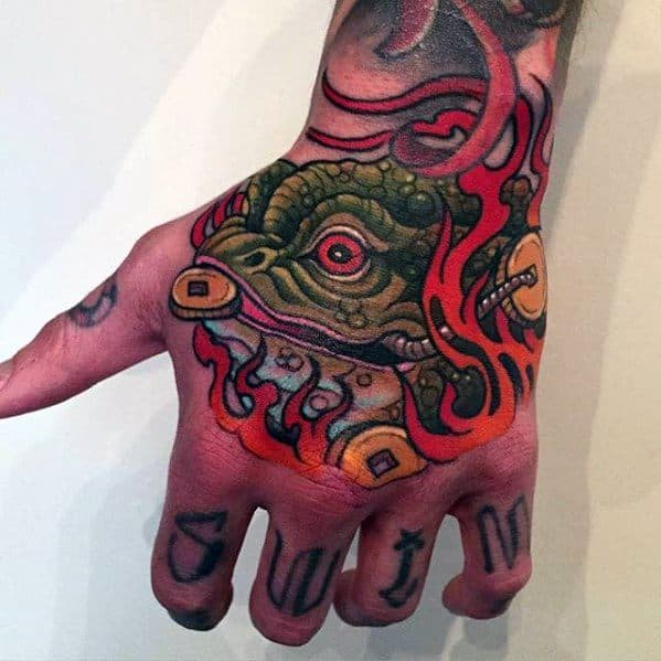Mens Hand Jin Chan Chinese Tattoo With Toad Design On Hand