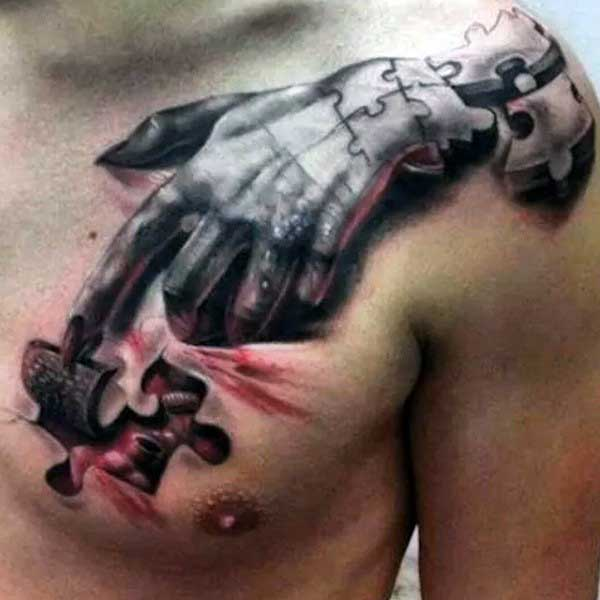 Mens Hand Puzzle Piece Tattoo On Chest With Ripped Skin