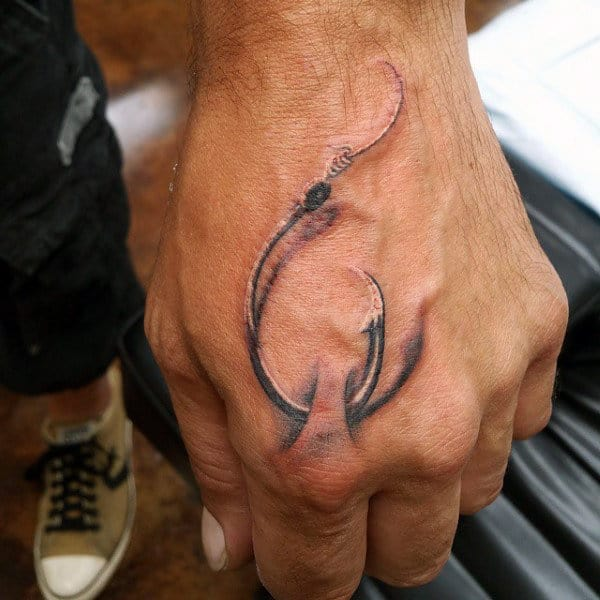 Mens Hand Tattoo Of Fish Hook Through Skin Design